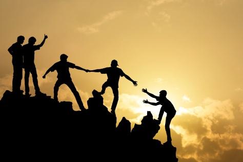Group of people on peak mountain  climbing helping team work , s